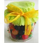 Petit pot pour les bonbons et papier vert