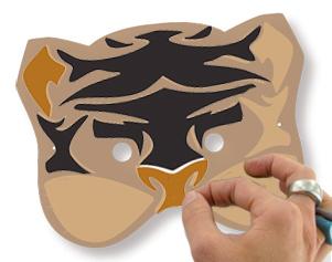 Coller les gommettes sur la tête de tigre