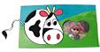 Décorer le cadre avec la vache et les fleurs