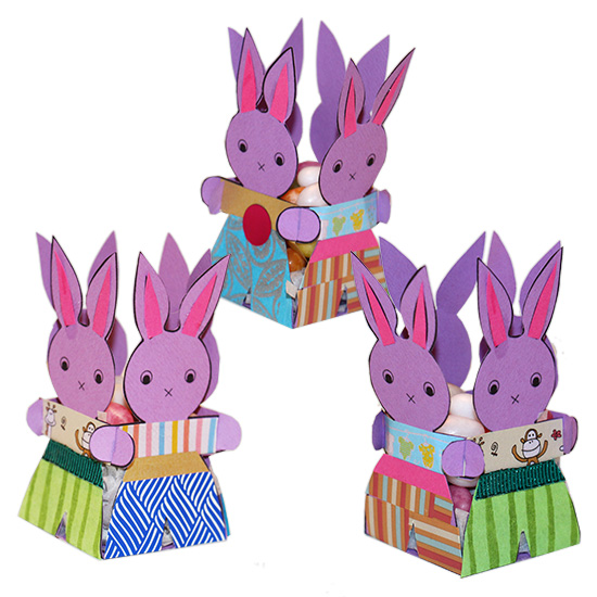 Quatre lapins de Pâques en corbeille