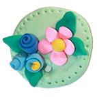 Modelage d'un médaillon rond à fleurs