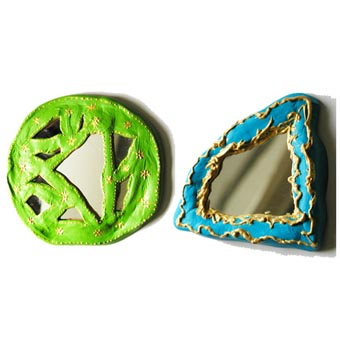 Miroir en argile décoré