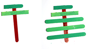 Coller les bâtons pour faire les branches du sapin de Noël