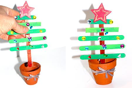 Planter le sapin de Noël en bâtons dans le pot
