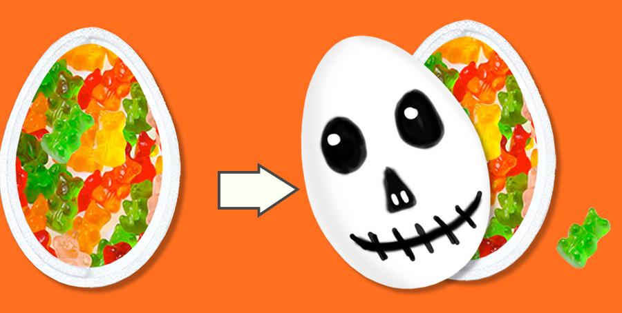 Mettre les bonbons dans la boite fantôme d'Halloween