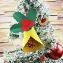 Décorations de Noël en forme de cloche à fabriquer pour décorer le sapin de Noël. C'est une activités simple en papier à faire avec les maternelles comme avec les plus grands.