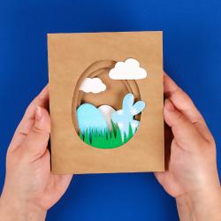 La carte de Pâques 3D est une jolie carte de Pâques avec un déco d'oeuf et de lapin collés sur différentes couches de papier. Une bonne idée d'activité à faire avec les enfants.
