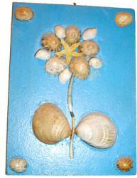 Fabriquer un tableau de coquillages pendant les vacances