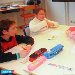 Le droit à l'école primaire gratuite et obligatoire