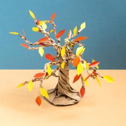 Fabriquer un arbre d'automne n'a jamais été aussi facile. Découvrez le DIY pour faire un arbre en papier pour l'automne avec ses feuilles jaunes et orange qui tombent.