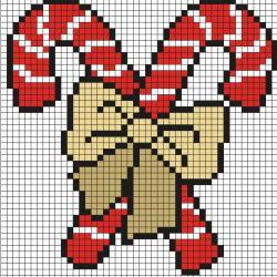 Découvrez comment réaliser ces délicieux sucre d'orges grâce au Pixel Art. Pour cela, prenez une feuille quadrillée et reproduisez chaque carré coloré afin de créer petit à petit un sucre d'orge puis deux pour les enfants sages.