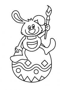 Un coloriage paques représentant un lapin et son pinceau sur son oeuf de Pâques. Un motif à décorer à télécharger et à imprimer pour votre enfant. Une fois imprimé, ce motif peut se reporter sur du bois, du verre, de la terre cuite, du carton, du papier o