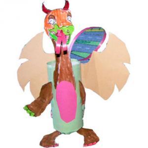 Fabriquer un dragon en carton avec un rouleau de carton et un coloriage. Ce dragon est réalisé avec un rouleau de carton et un coloriage de dragon découpé. Activité envoyée par Isabelle
