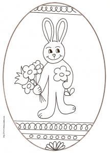 coloriage d'un oeuf de Pâques médaillon : lapin aux fleurs