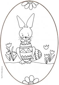 coloriage d'un oeuf de Pâques du petit lapin tenant un oeuf