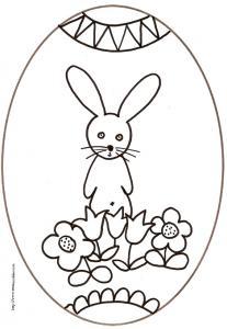 coloriage d'un oeuf de Pâques du petit lapin étonné