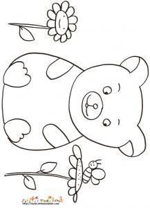 Coloriage petit ours assis dans les fleurs