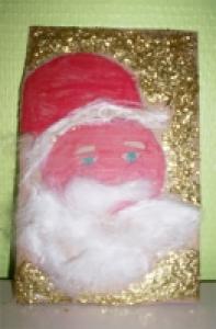 Réaliser une carte Père  de Noël en suivant les explications d'Erwan