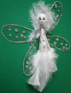 Ange de Noël en plumes blanches