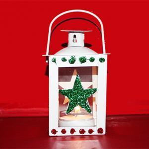 Lanterne de Noël en métal décorée de paillettes