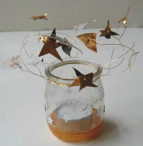Photophore décoré d'étoiles dorées en métal
