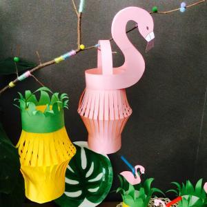 Des lanternes de papier en forme d'ananas et de flamant rose