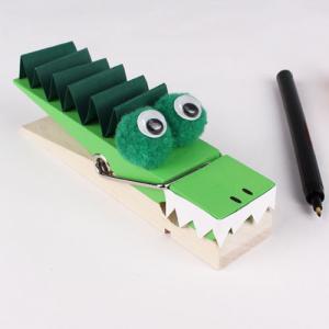 Un tuto pour apprendre à faire un crocodile à partir d'une pince à linge