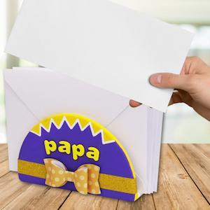 Decouvrez comment realiser ce super range courrier noeud papillon a personnaliser DIY. C'est une très bonne idee de cadeau pour la fete des peres ou pour offrir a noel a son papa adore. C'est une activité simple a realiser et qui, en plus d'etre tres joli