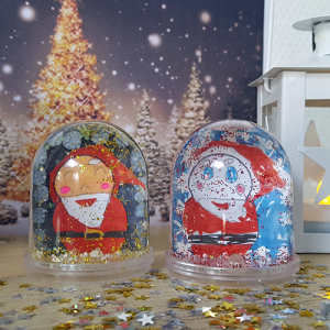 Personnaliser cette boule à neige avec un père Noël et des paillettes
