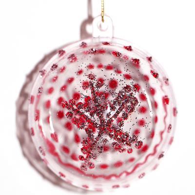 Boule de Noël en transparence rouge et paillettes