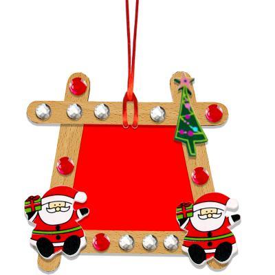 Tableau de Noël en bâtons de bois