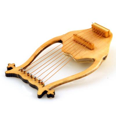 lyre - mot du glossaire Tête à modeler. Définition et activités associées au mot lyre.