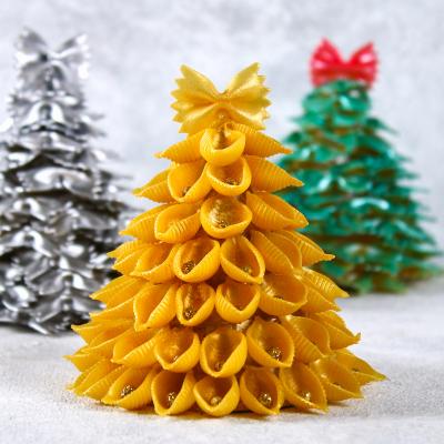 Fabriquez un mini sapin en pâtes facilement grâce à notre tuto. Un mini sapin de Noël à fabriquer gratuitement